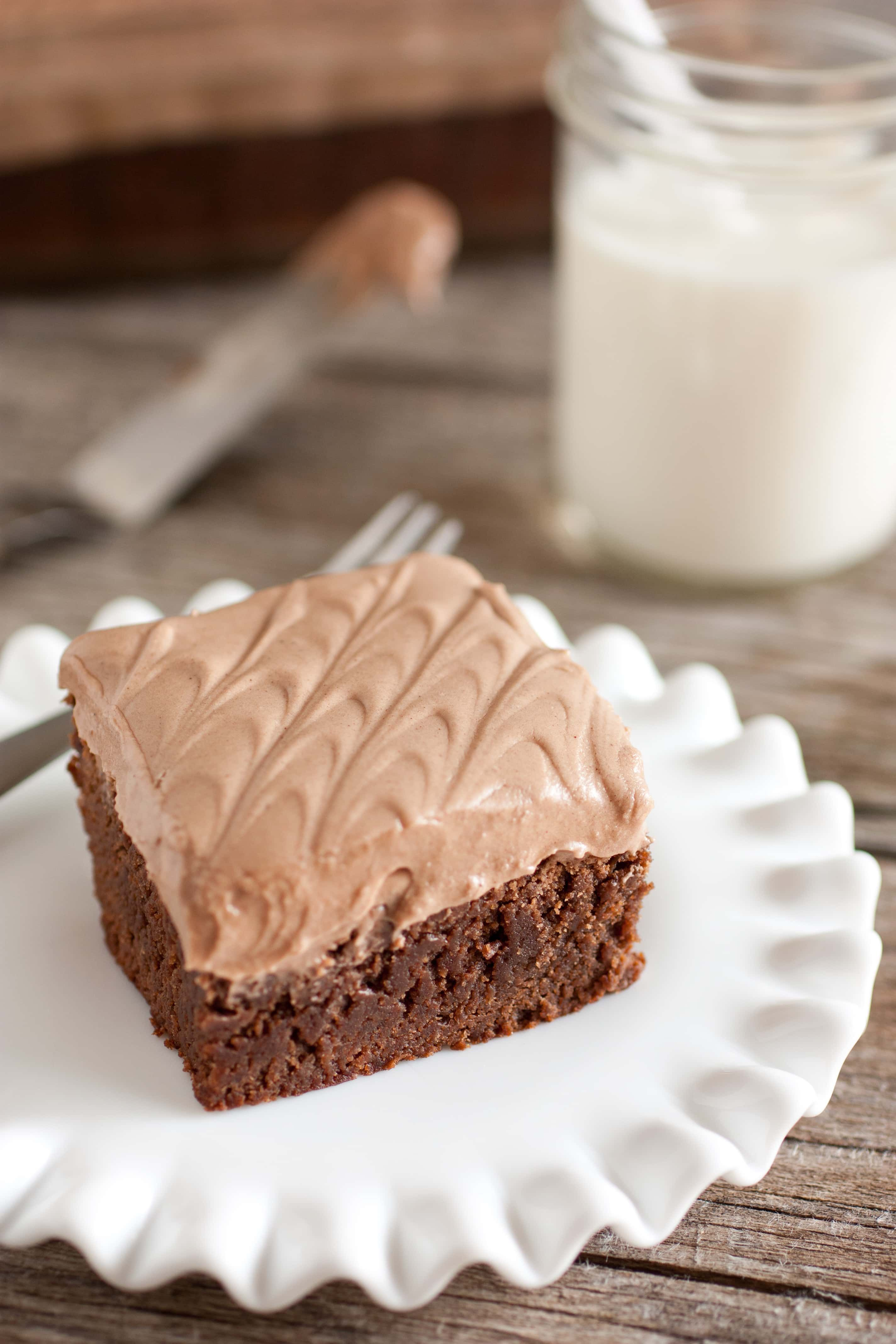 Browniesare topped with the most amazing chocolate frosting. These homemade brownies are almost cake-like, and they're made with cocoa powder instead of chocolate. Be careful, these are addicting!#chewybrownies