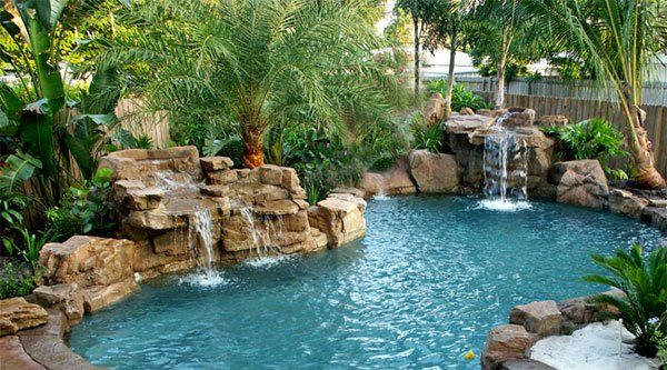 15 Pool Waterfalls Ideas For Your Outdoor Space Home Design Lover Swimming Pool Waterfall Pool Landscaping Pool Waterfall