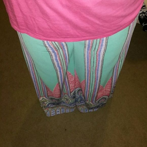 Boutique Palazzo Pants & Boutique comfort tee Love these bright colorful pants. This outfit is perfect for spring! This outfit has been worn twice. No stains, tears, or any other damage. The reason for selling this outfit is its too big now. Great price for entire outfit! Pants Wide Leg