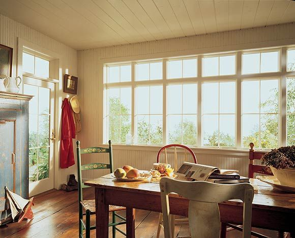 This kitchen gets its cottage feel from wainscoting, paned Andersen ...