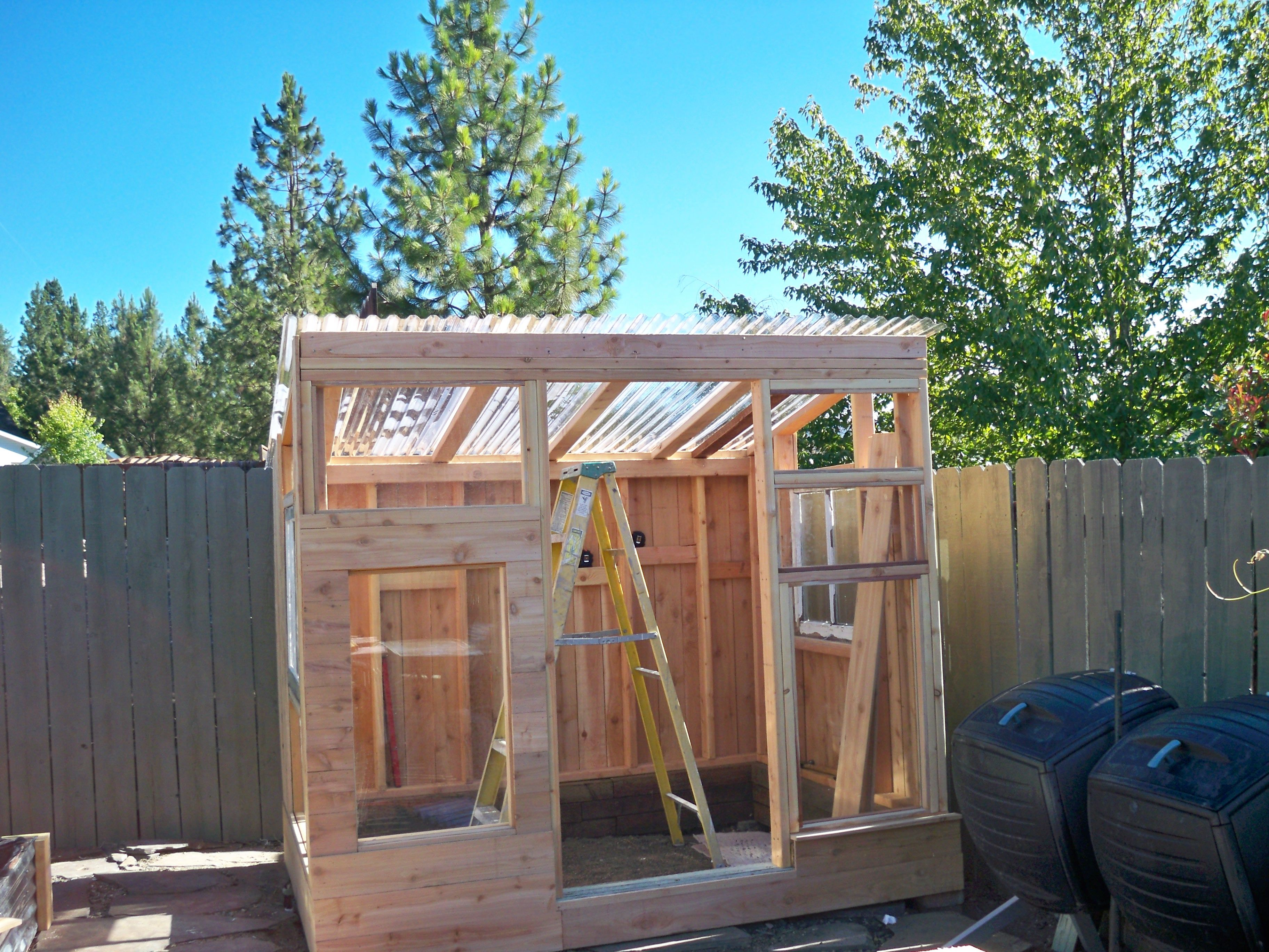 Used Inexpensive Fence Boards For Siding And Stained With Redwood