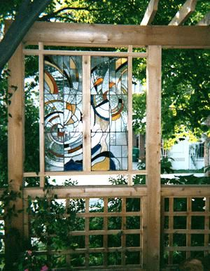 Tip use a stained glass garden panel to block an for Garden decking glass panels