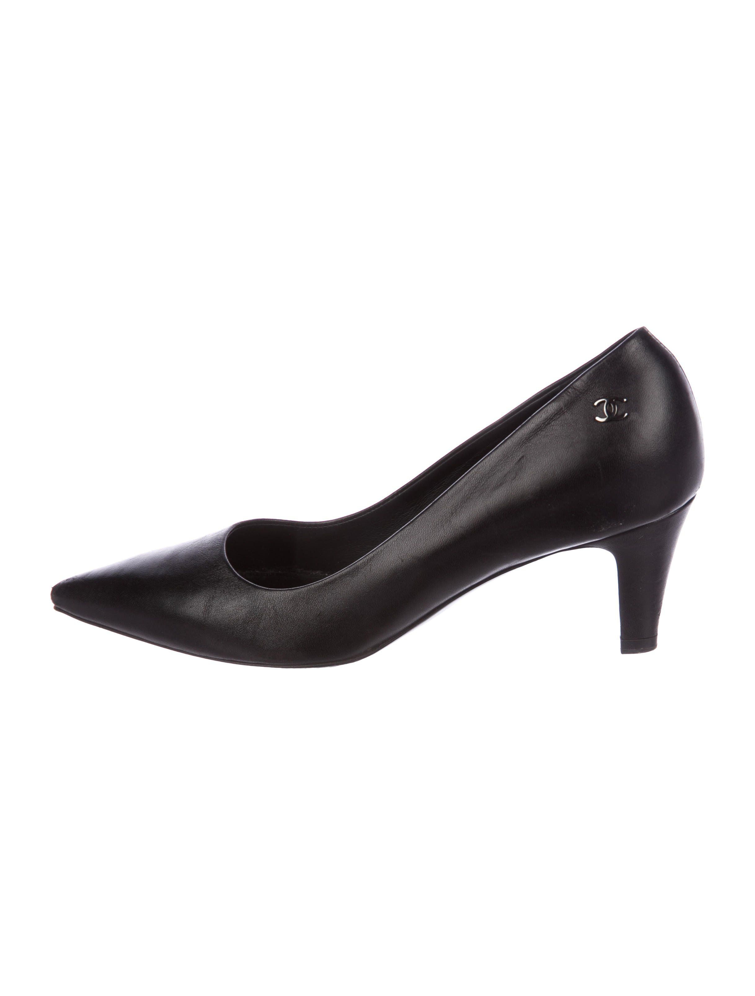 151e23f02821 Black leather Chanel pointed-toe pumps with silver-tone interlocking CC at  sides and covered heels.