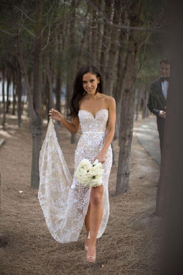 A sheer wedding dress, intricately beaded lace paired with a nude ...