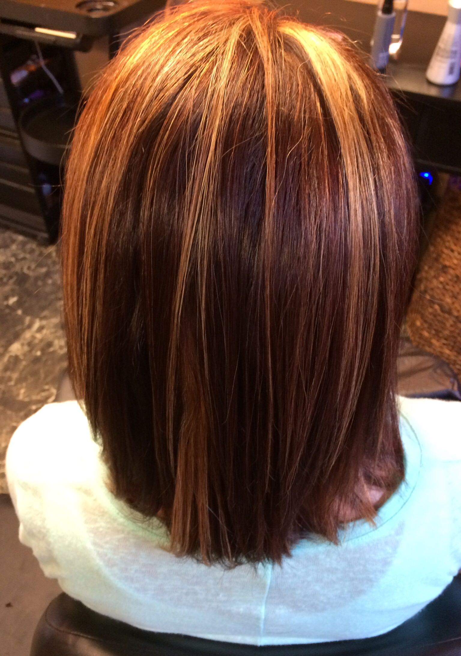 Dark chocolatecopper base with blonde highlights and peekaboo