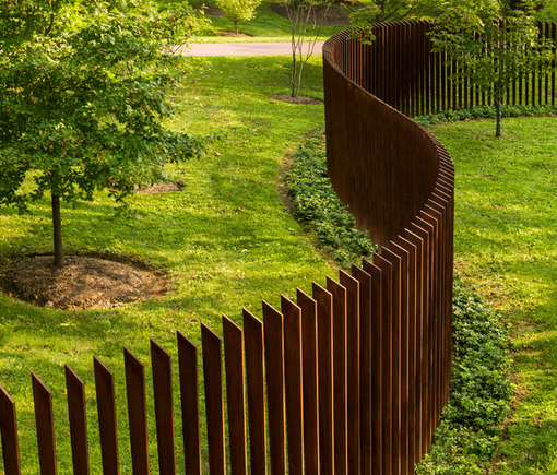 Sculptural fence made from steel panels