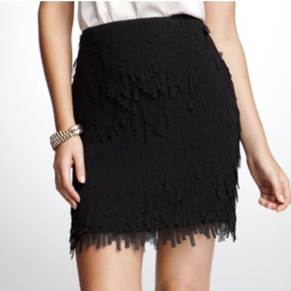 Adorable fringe skirt(size 2Petite) Very good condition. Beautiful skirt. 94% polyester 2% spandex Ann Taylor Skirts Midi