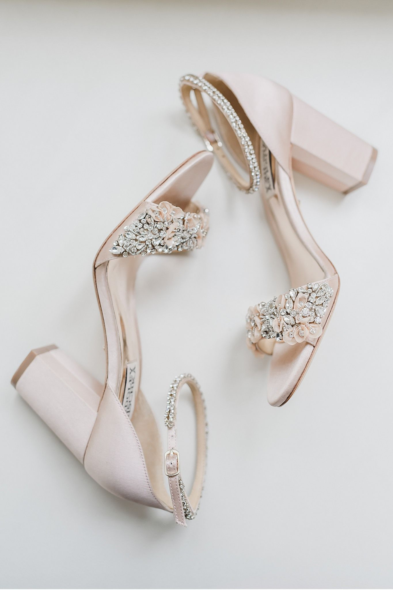 The simplicity of a pair of soft blush Badgley Mischka shoes can't be matched for a bride on her Wedding Day! | Annie Sharp Photography #MoonstoneManor #CameronEstates #LancasterPA #SummerWedding #LancasterPAWeddingPhotographer #LancasterPAWeddingPhotography #MoonstoneManorWeddingPhototgrapher #BadgleyMischkaBridal #BadgleyMischkabridalshoes #blush #weddingdetails #destinationphotographer #PhiladelphiaWeddingPhotographer #Phillybride #PhillyWedding