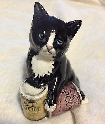 Royal Doulton Black Cat Figurine grumpy looking with cat food