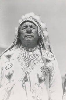 Fish Wolf Robe - Blackfoot (Siksika) - circa 1930. We met him in 1931 & 32.  I was nine months old.  Later there is a picture of my sister In a war bonnet that he gave us.  JKR