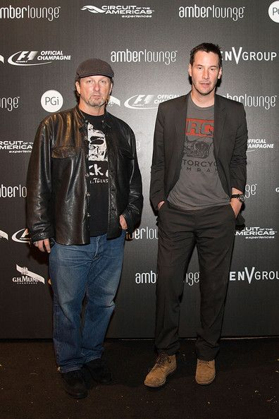 Keanu Reeves Photos Photos - Co-founders of Arch Motorcycle Company Gard Hollinger (L) and actor Keanu Reeves celebrate F1 with G.H.MUMM during the Original F1 After-Party at Amber Lounge on November 2, 2014 in Austin, Texas. - G.H.MUMM Victory Lounge Afterparty
