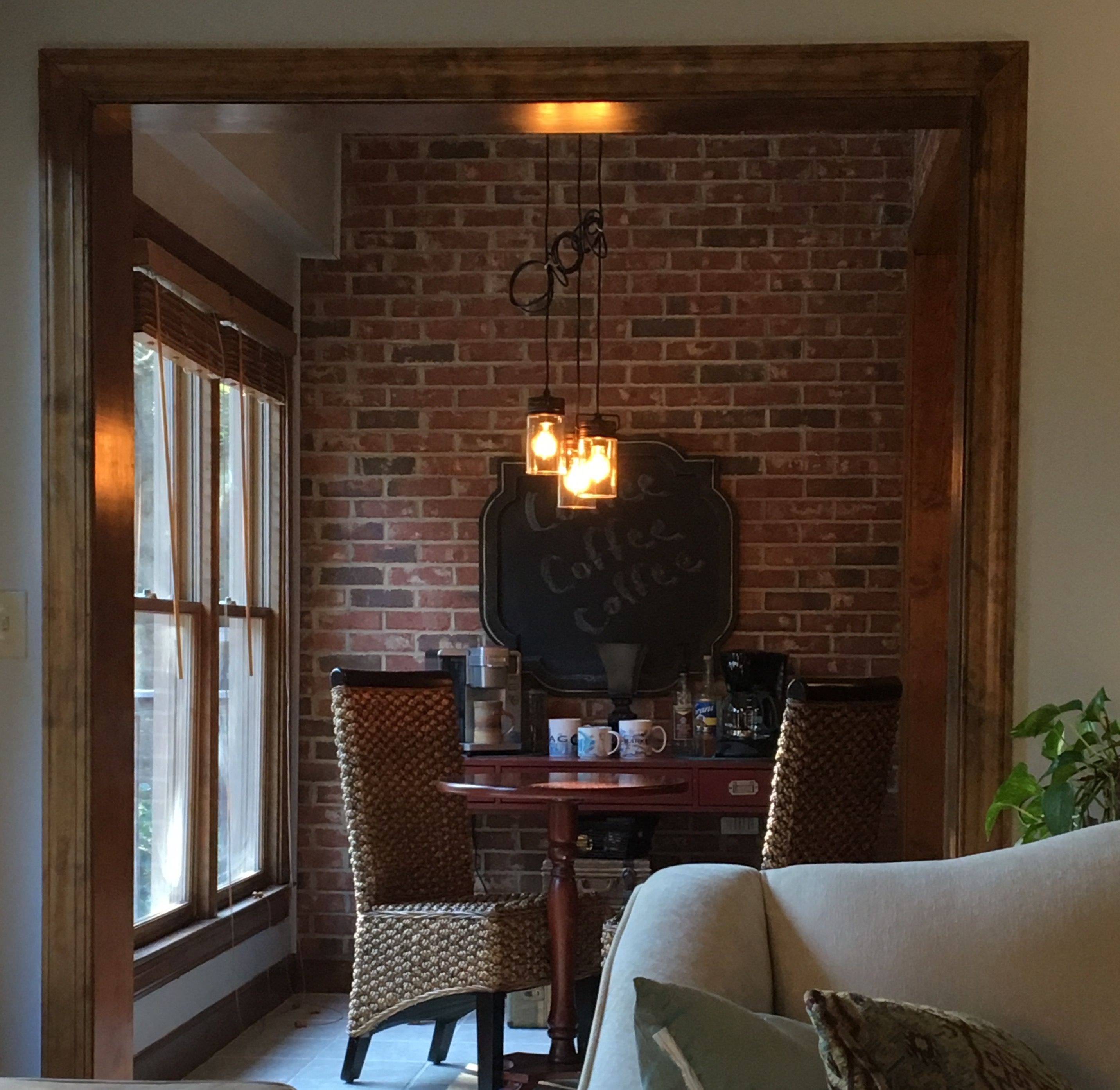 Coffee Room With Dark Trim And Brick Pendant Light From