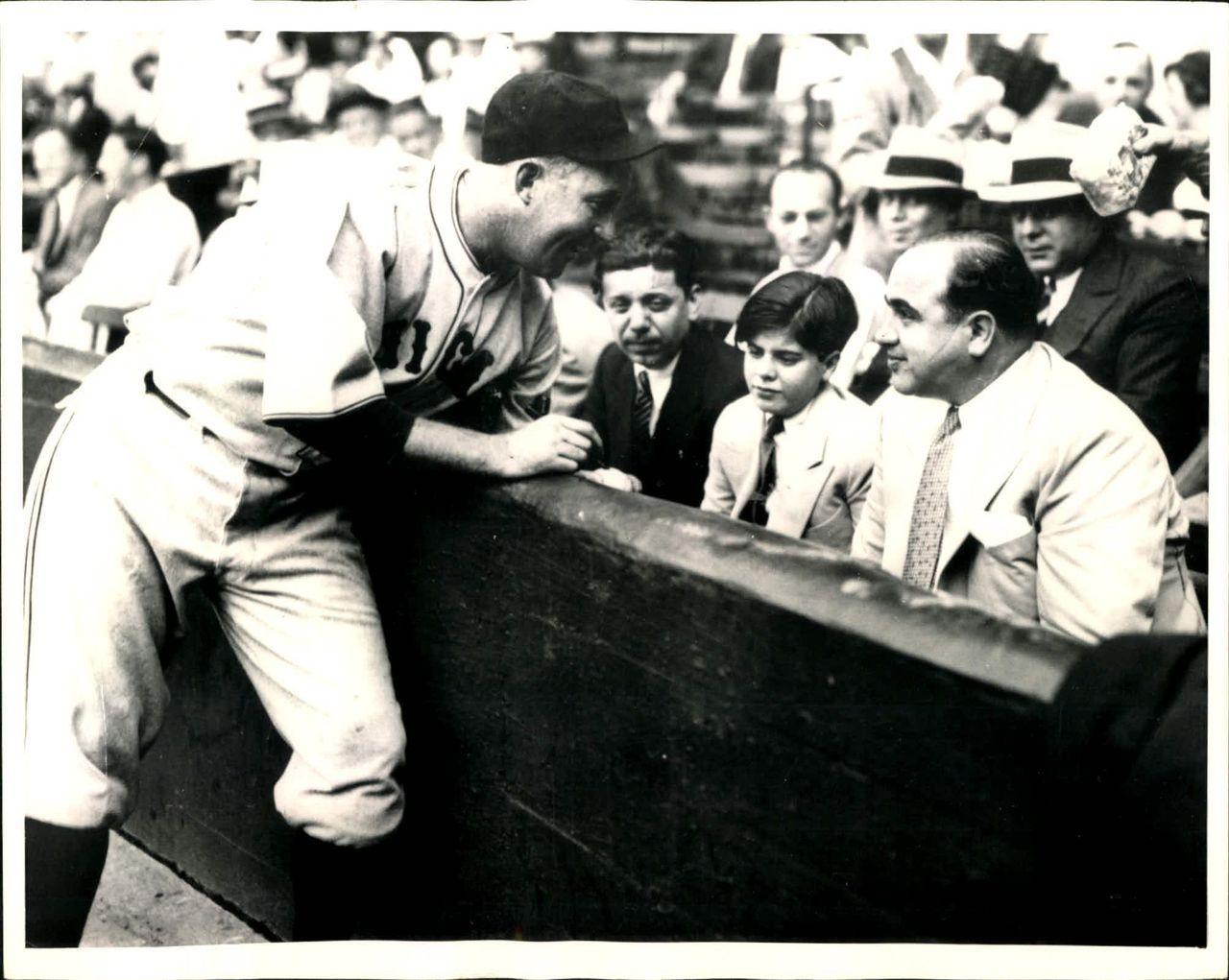 9a384863636 Gabby Hartnett of the Chicago Cubs autographs a ball for Al Capone s son  Sonny