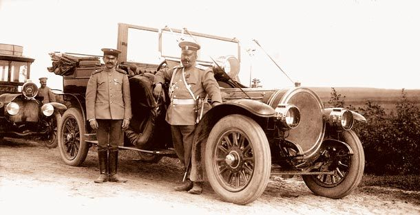 NIKOLAY II'S STOLEN CAR ~ Tsar Nikolay II owned several fashionable cars and was a good driver. Here is a photo of 1912 with one of his Delaunay-Belleville. To the right there a Russian, Vladimir Orlov who gave N II lessons on driving. To the left there is Adolf Kegress, a French and a personal driver of NII since 1906 - and a person who stole the car in 1917 to leave for Paris after Russian Revolution. The car was found in Stockholm, in one of hotels, where Kegress sold it on his way home.