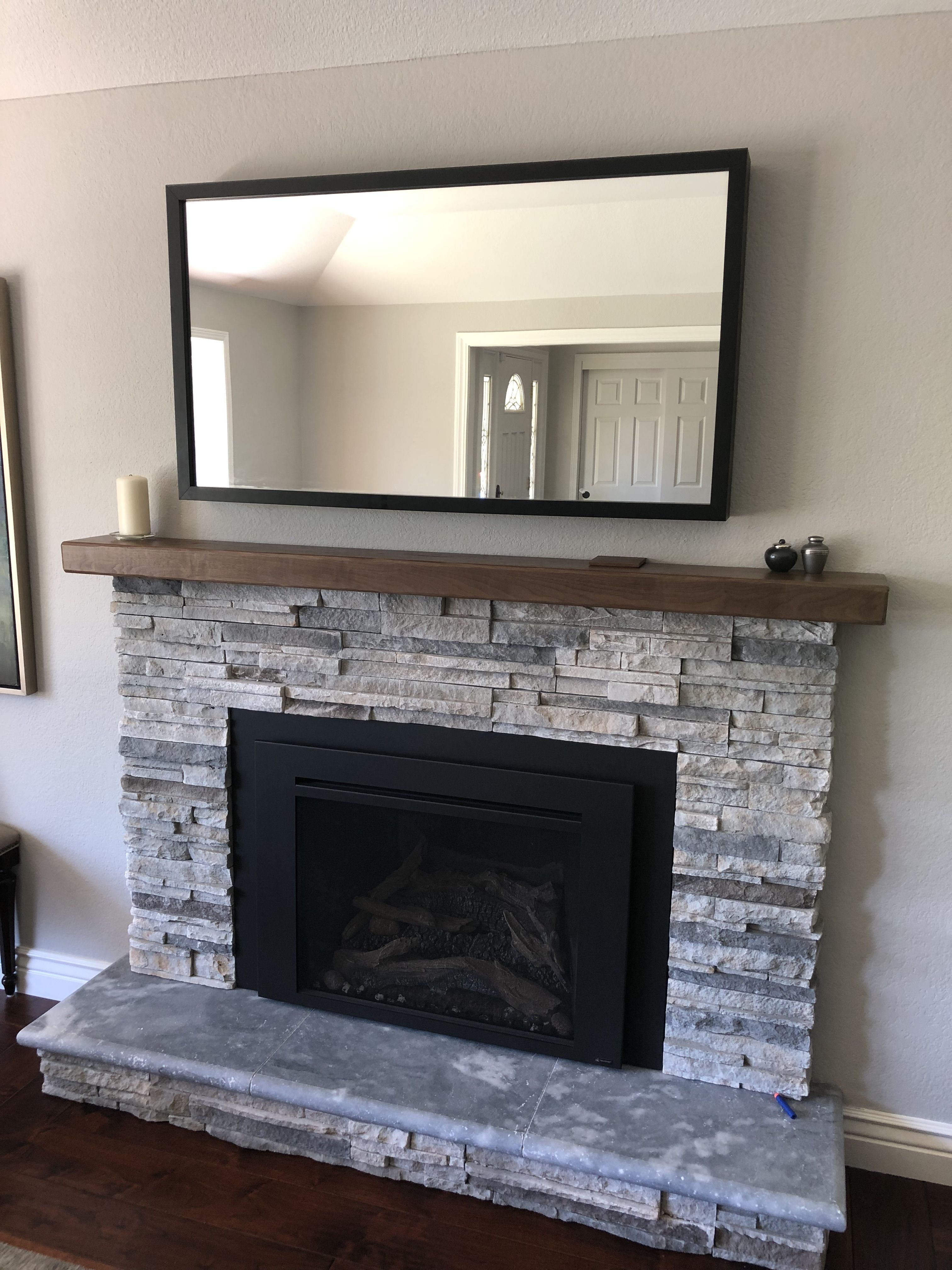 Walnut Mantel And Stacked Stone Gas Fireplace Within Hidden Tv