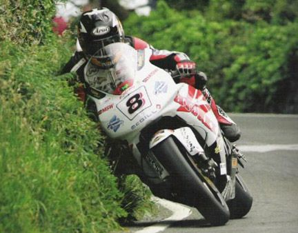 Extreme gardening: Guy Martin cuts the hedge at the TT