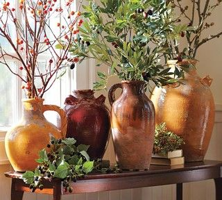 Vases in Tuscan colors, dark wood and plants/greenery to round out the Tuscan color palette. A Tuscan home is warm and inviting, and is inspired by the textures and colors found in nature. Color options for Tuscany decor are gold and yellow, dark green and sage, different shades of browns and ochre/red ochres.