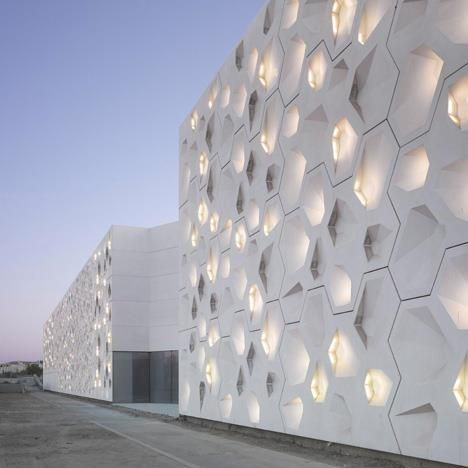Rooms and surfaces are generated from a complex web of hexagons at this contemporary arts centre in Córdoba, Spain.