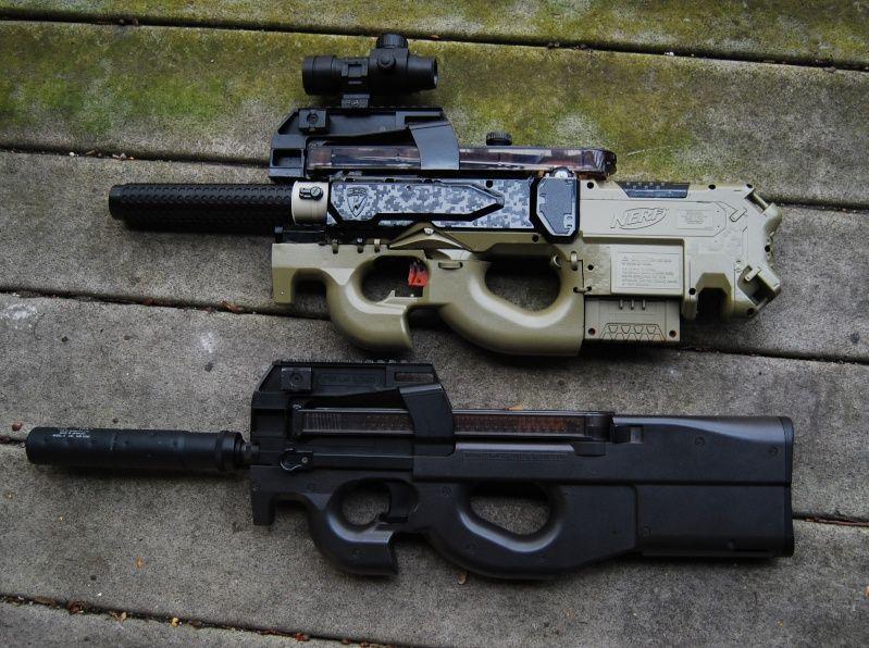 Nerf Rayven P90 mod, alongside an airsoft P90. Nice job!