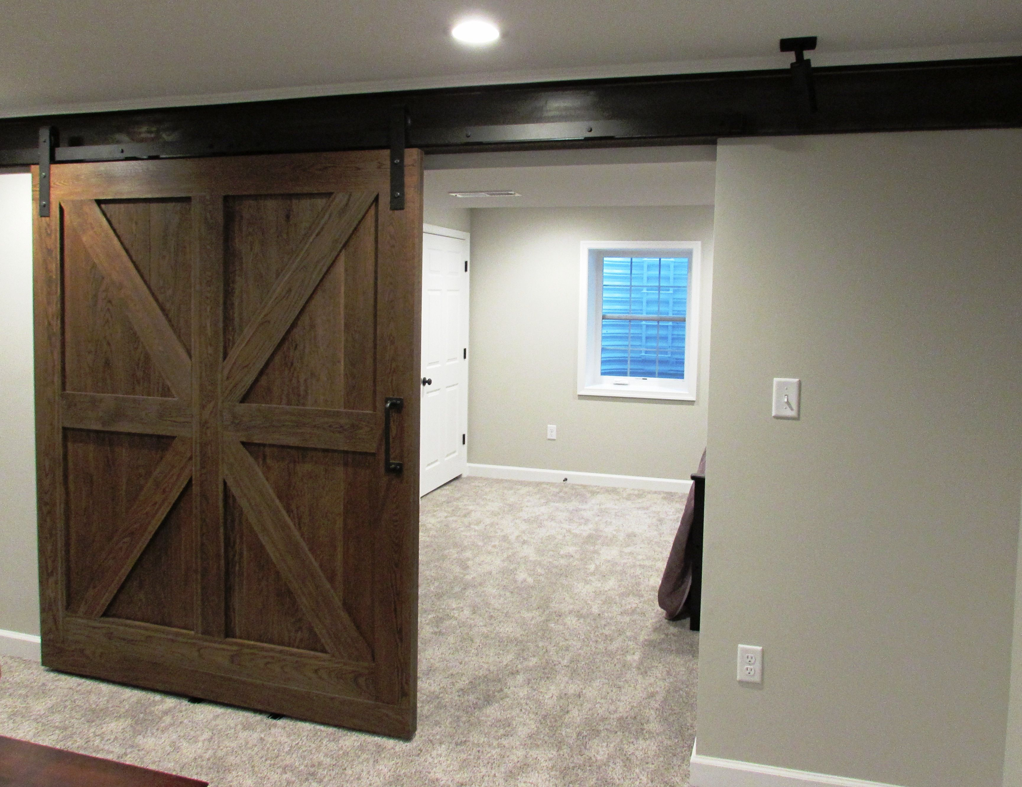 Great use of rolling barn doors on existing steel beam in