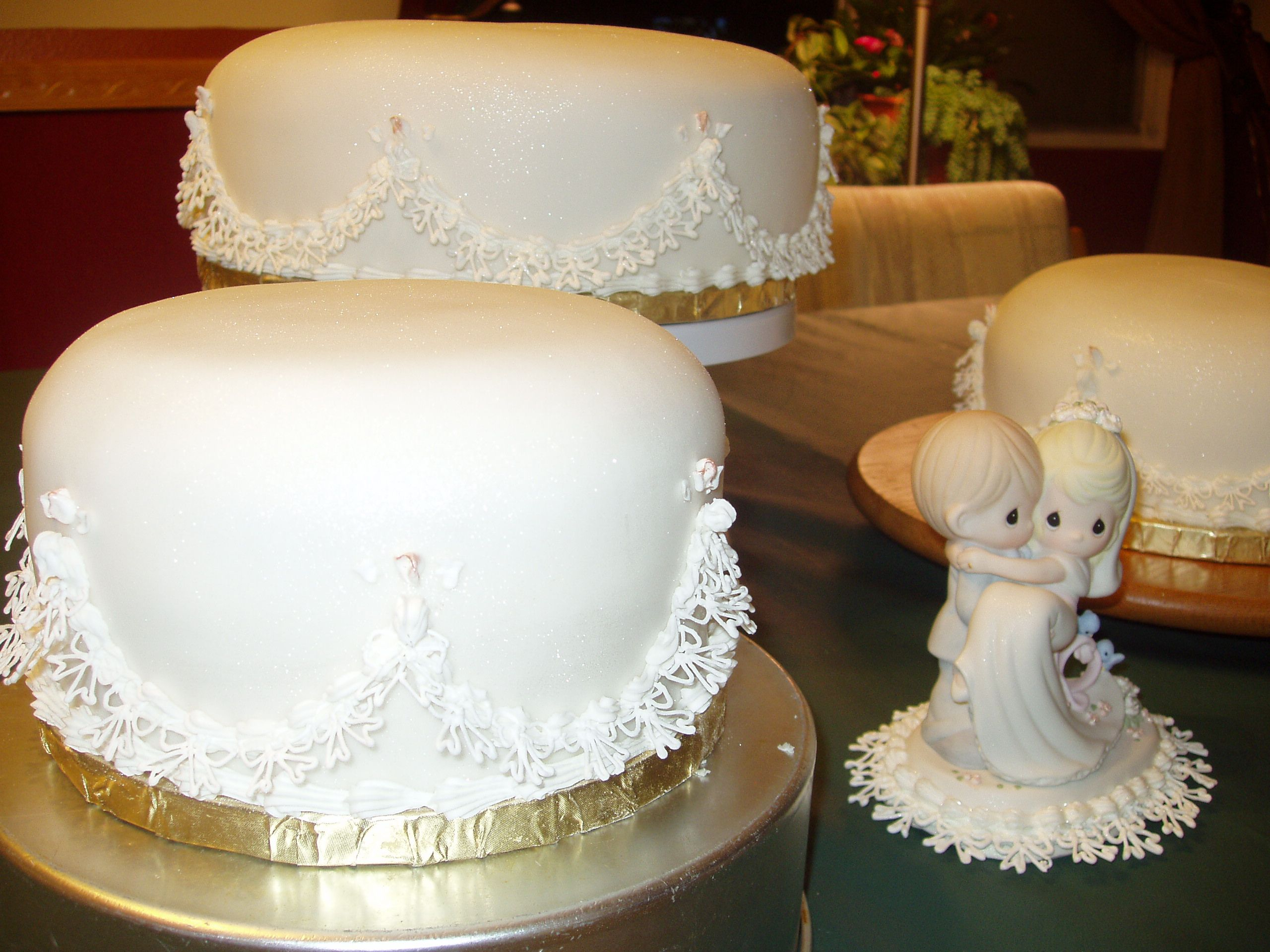 lacy elegance - added royal icing lace to bottom of Precious Moments ...