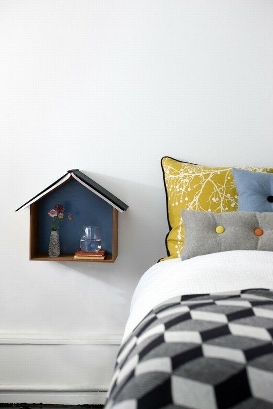 maybe not in the shape of the bird house but mounting a bed side table on the wall is a smart idea