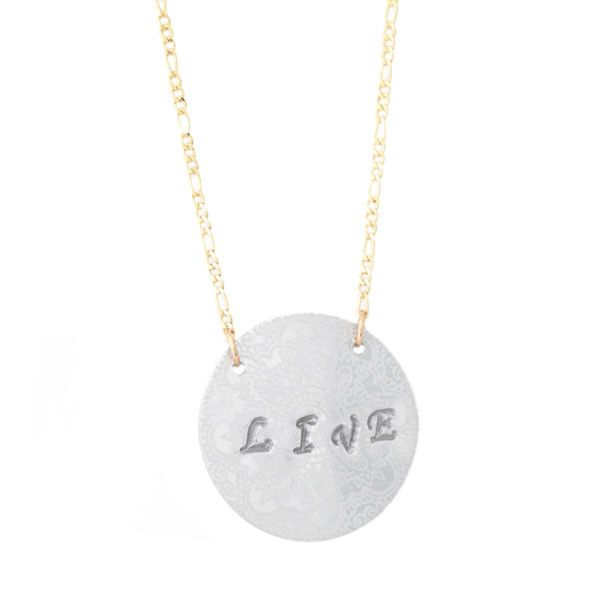"""LIVE STAMP NECKLACE  """"The most important thing is to enjoy your life - to be happy - it's all that matters.""""  - Audrey Hepburn   Description: 14K gold filled necklace and silver aluminum disc. Hand stamped with the word 'live', this necklace measures 16 or 18 inches in length."""