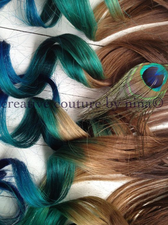 "Peacock Feather Hair Extensions//Peacock Ombre//Peacock DipDye//BurningMan//Teal, Emerald Green and Blue Hair //(7) Pieces//20"". $245.00, via Etsy."