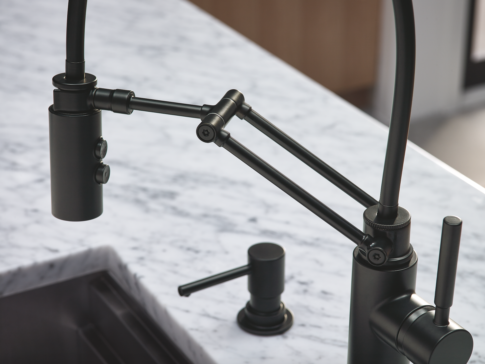 kitchen spaces black faucet for kitchen The Solna Articulating Kitchen Faucet by Brizo in matte black was the hero in this modern kitchen space designed by