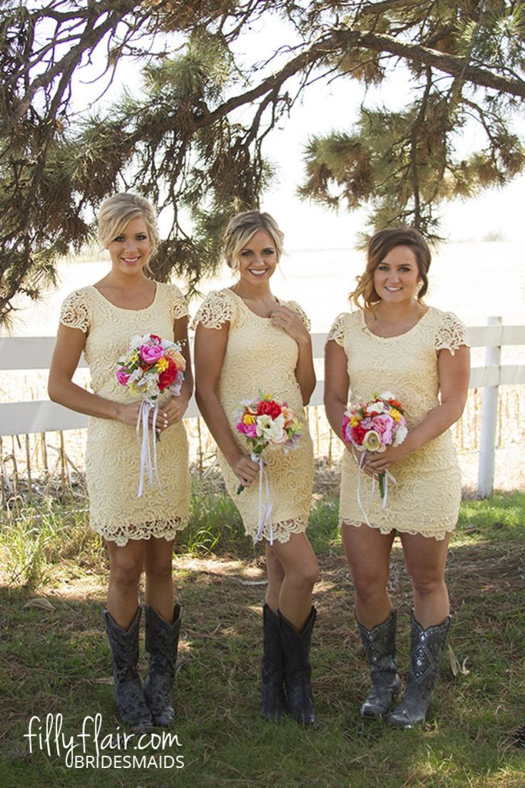 We love a lace bridesmaid dress with boots for your country wedding