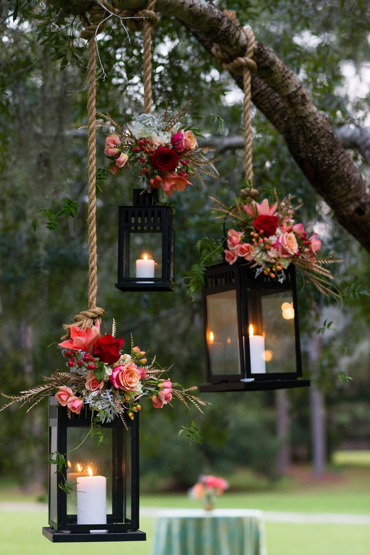 diy outdoor wedding lighting ideas%0A Love the pair of bright floral bouquets against the dark color of the  lanterns  beautiful    Outdoor Wedding LightsOutdoor