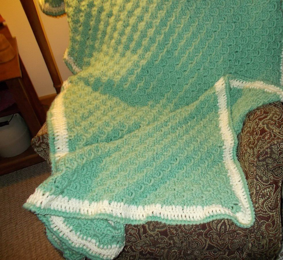 This is a c2c, corner to corner, I need to steam the edgs to make it lay flat, and it will be all done.