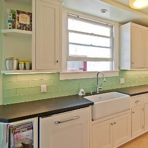 Love Subway Tile For A Modern Retro Kitchen Also The Simple White Cabinet Doors Green Kitchen Backsplash Kitchen Backsplash Tile Designs Kitchen Tiles Design