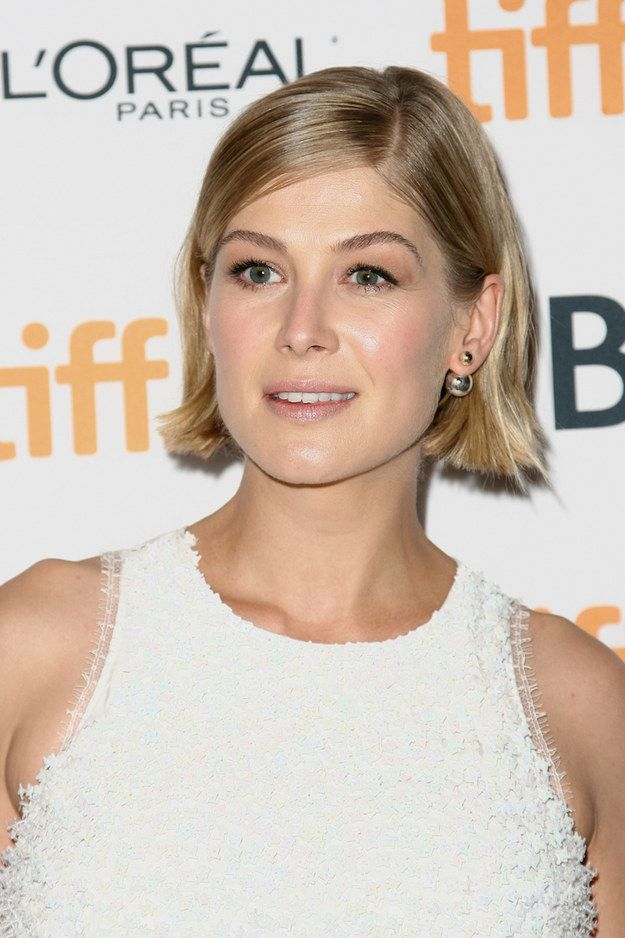 And gaze upon the effortless way her hair is tucked behind her ears. | 21 Times Rosamund Pike's Short Hair Gave You Life