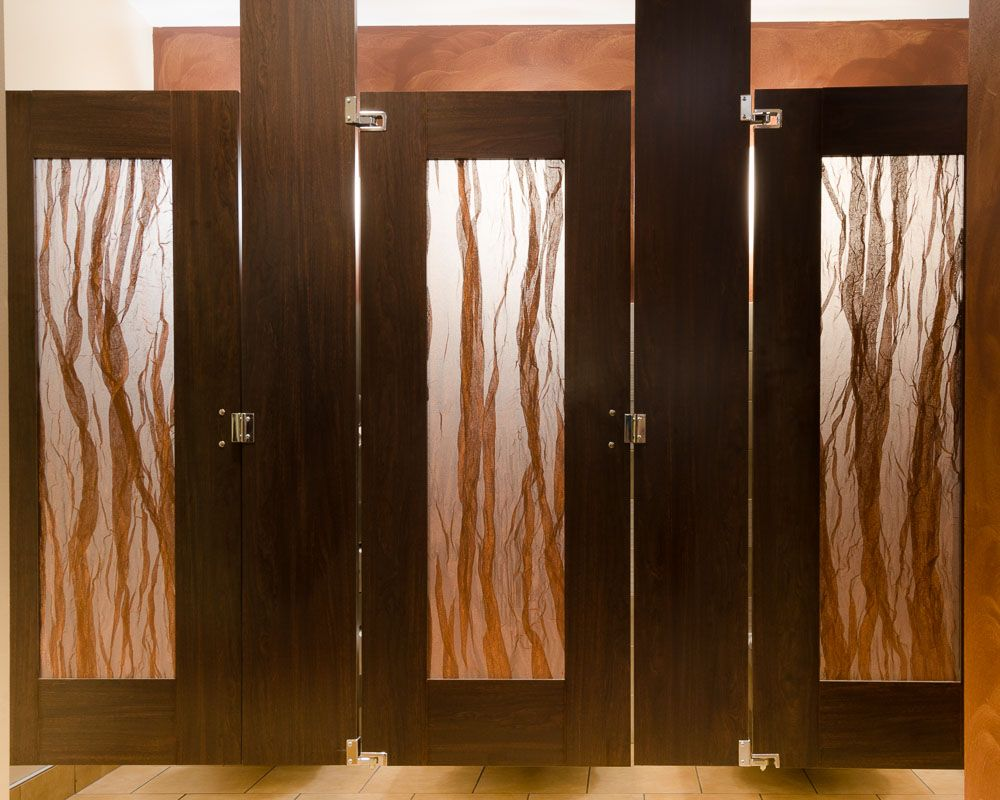 Swept Copper Acrylic Insert In Ceiling Hung Toilet Partition Doors By  Ironwood Manufacturing.