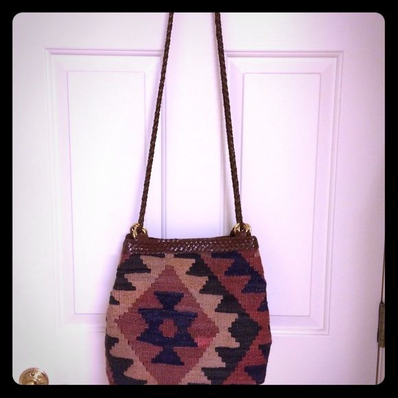 """Beautiful Knit Bag Beautiful knit crossbody/shoulder bag.  Double strap.  Magnetic snap closure.  Gold hardware.  Brown faux leather trim.  Interior has a zippered pocket.  EUC.  Marks on bottom.  Some light wear/piling.  21"""" strap drop.  11x5x10. Bags Crossbody Bags"""