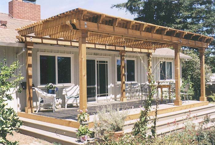Covered Back Deck This small latice-covered deck | Pergola ... on Covered Back Deck Designs id=39932