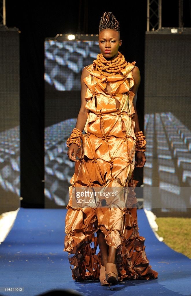 1c7e06c7296f A model presents a creation by Senegalese fashion designer Oumou Sy, during  the…
