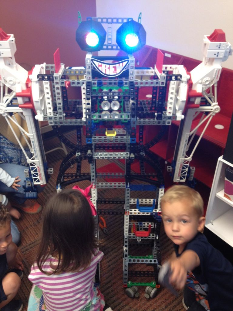 "Made out of Rokenboks, R2 Boo-Hoo is our electronic mascot. He moves. He lights up. Kids can learn about engineering and electricity all while singing, ""I'm a Robot""."