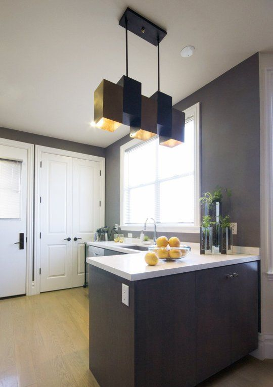This Kitchen Demonstrates The Power Of One Awesome Light Fixture Prepossessing Light Fixtures For Kitchen Decorating Inspiration