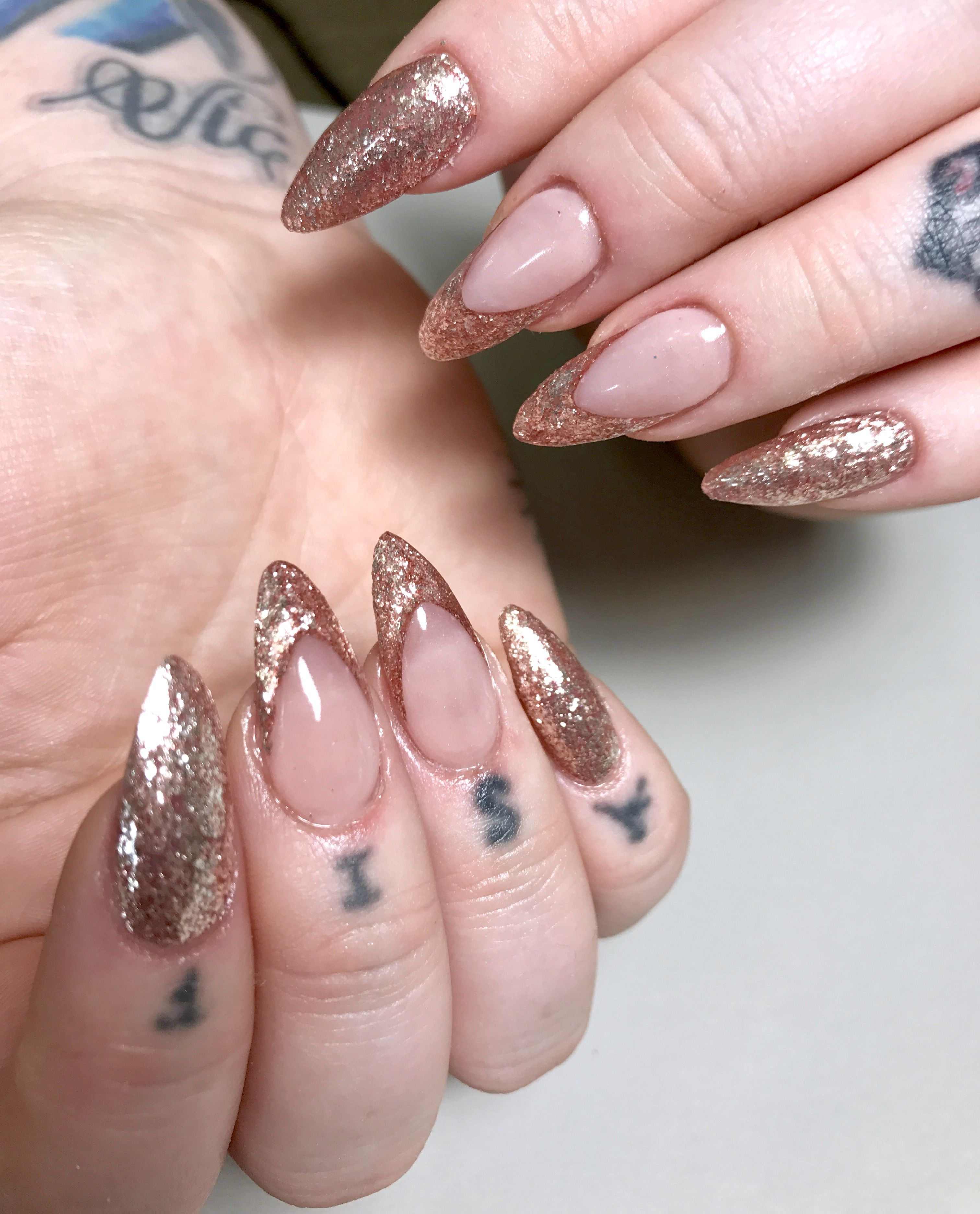 Pink Neutral Nails In An Almond Shape With Glitter Embedded Or