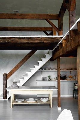 White floors and stairs and a kitchen in the corner