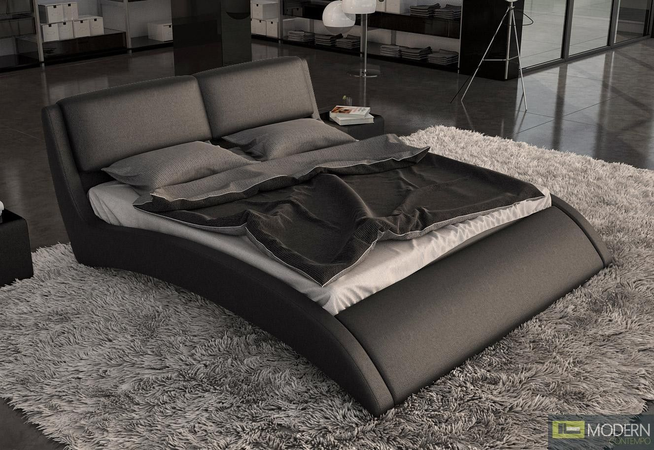 This Modern Bed Is Upholstered In Smooth Black Leather And Has A