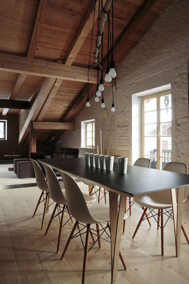 Aménagement design pour cette salle à manger en pierre et bois