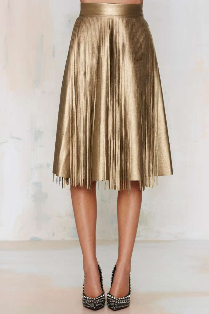 82a650987a The Frisky Gypsy Skirt is made in a metallic gold vegan leather and  features fringe detail and A-line silhouette.