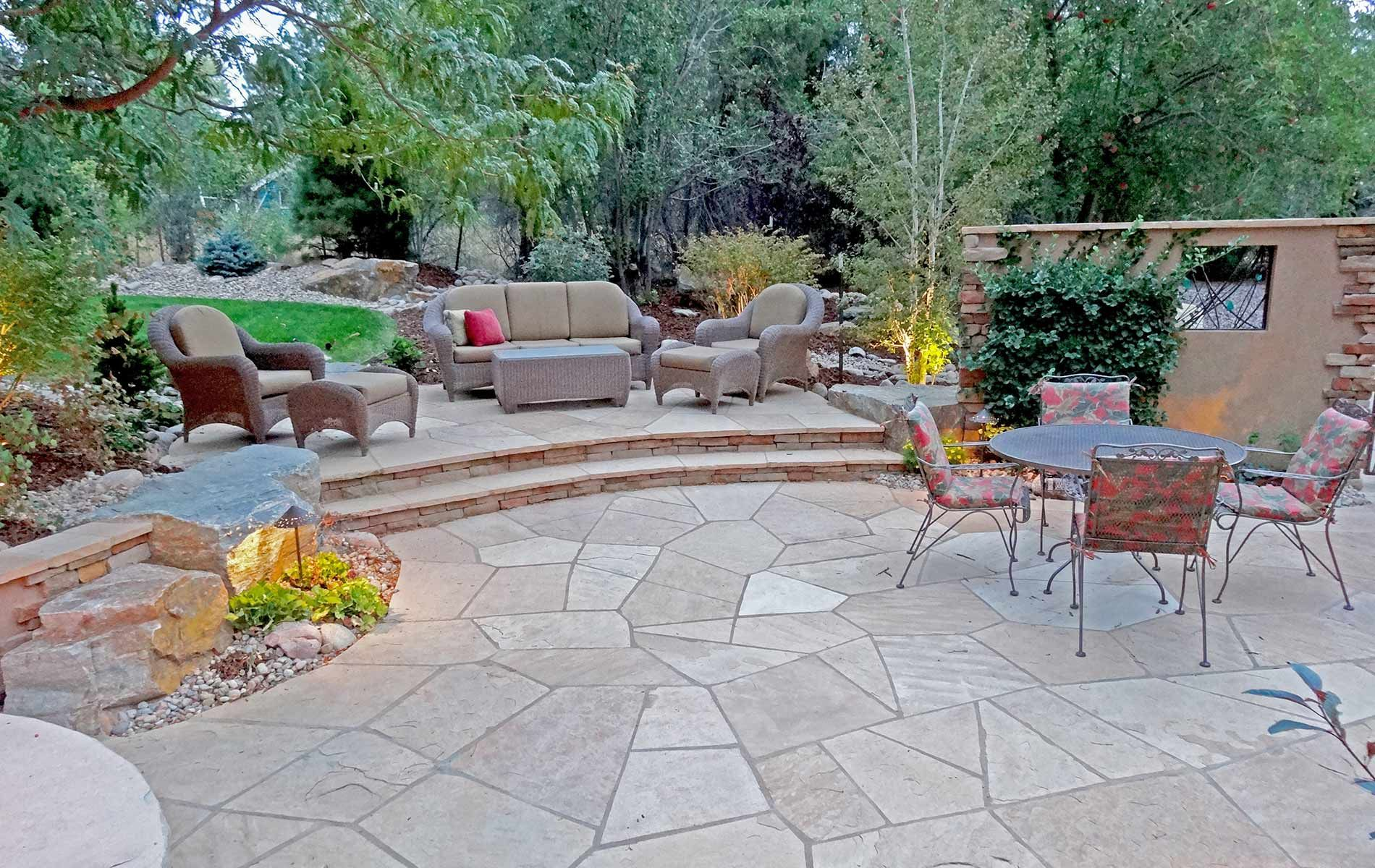 Irregular Arizona Buff Flagstone Patio With Strip Stone Stairs Leading