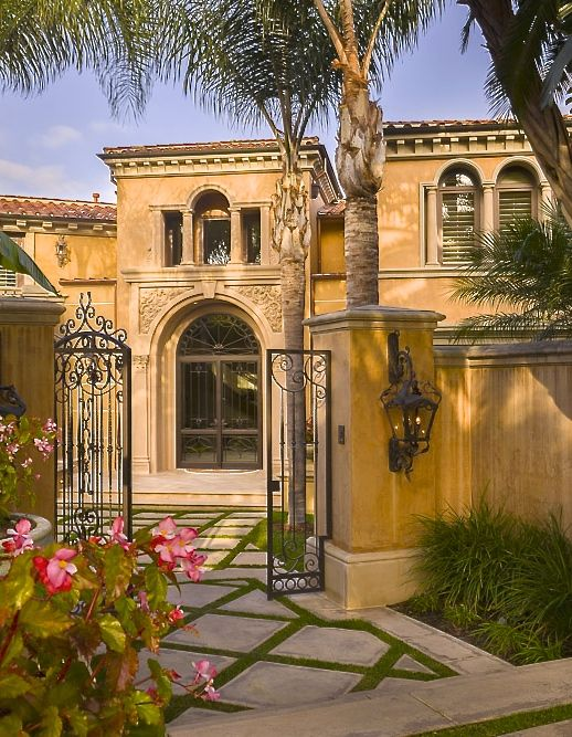 Mediterranean with charming iron gated entry courtyard for Courtyard in front of house