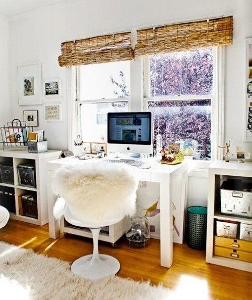 window shades, wall art, magazine rack, desk, chair, rug, storage bins, shelves