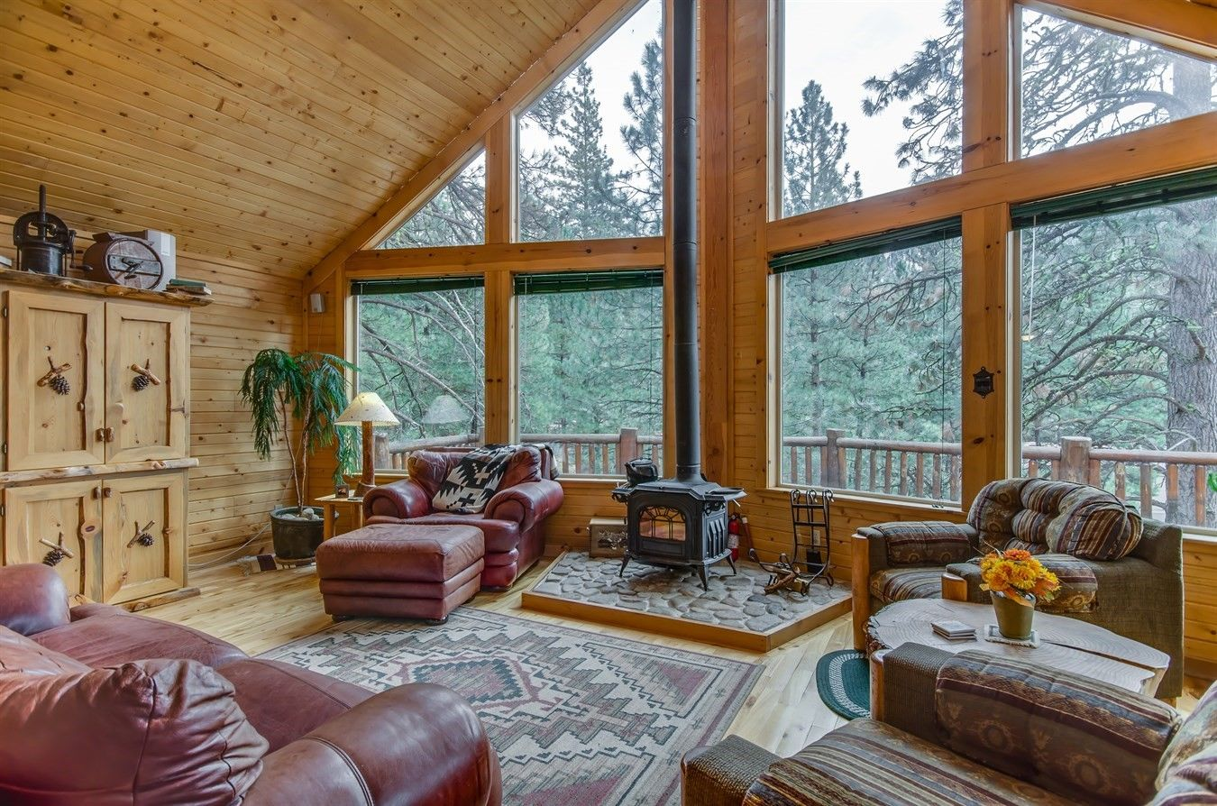Rustic Living Room With Vaulted Ceilings Wall Of Windows