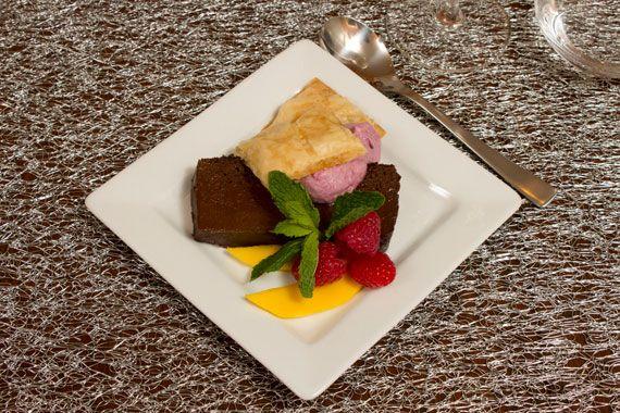 Chocolate terrine with black raspberry puree, crispy fillo dough, and mango.